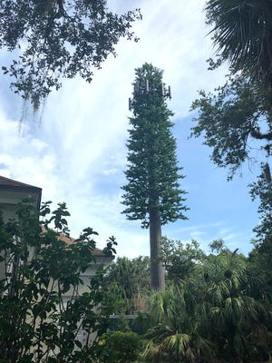 Reaching over the treetops at Indian River Shores Town Hall, the new 115-foot cell tower still isn't expected to be in service until the end of 2018.