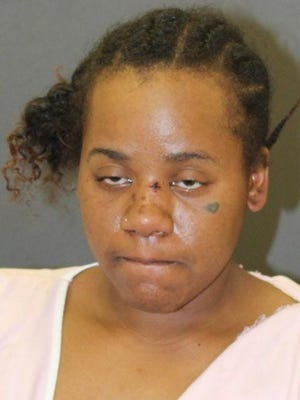 This photo provided by Baltimore Police shows Nichole George, charged in the shooting of an 11-year-old boy and his mother at a Baltimore playground.