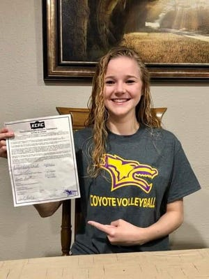 Brooke Smith of Macksville High School credits her coaches and parents for their support at she inks a letter of intent to play volleyball at Kansas Wesleyan in Salina this fall.