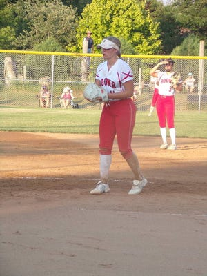 Emma Dighton gets read to fire a pitch during Boone's final home game July 7 at Creasman Field. Photo by Andy Heintz