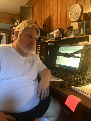 Ron Downey, a longtime local broadcaster, has a broadcast set-up in his home to do voiceovers for various radio and TV commercials, and has added a camera capable of recording podcasts.