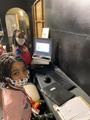 Campers working in the computer lab at the Super Smart Summer Camp.