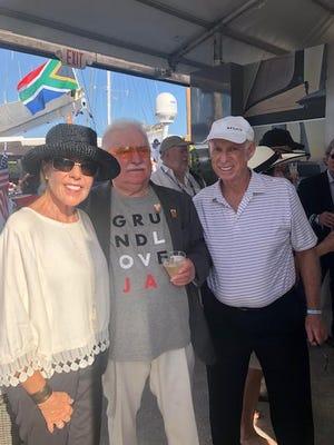 Pamela Freedman, Lech Walesa and Roger Freedman at the Miami International Boat Show.