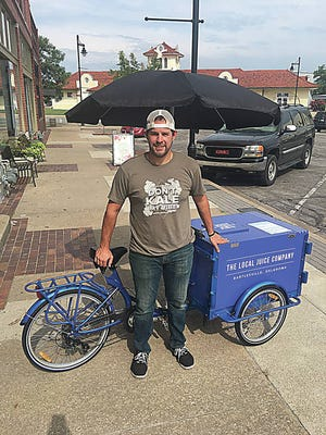 Owner Travis Yoder pedals a delivery bicycle for The Local Juice Company in Bartlesville. Kris Dudley/Examiner-Enterprise