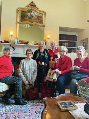 Pictured from left at the Christmas luncheon of the Columbia Branch American Association of University Women in December at Kathy Hasse's house are Kitty Chaffin, Gloria Dale, Nancy Hunter, Sue Greenfield, Linda Crone, and Kathy Hasse. Each member is holding purses filled with gifts that will be donated to needy women.