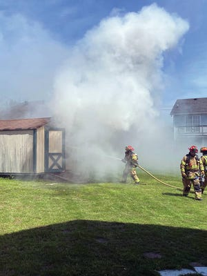 Smoke flows from shed fire at 1909 Bull Run Court around 2:15 p.m. Thursday. No injuries were reported in the incident.