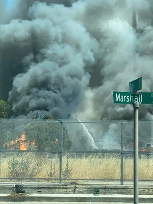 A four-alarm fire that started Sunday afternoon near the Rural Cemetery in the heart of Stockton has grown to four alarms. The Stockton Fire Department confirmed that at least three homes have burned and many more are threatened.
