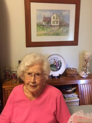 Jeanne Hough, of Hopewell, celebrates her 100th birthday June 9. This year also marks the bicentennial of Granger township, Ohio, named for Gideon Granger and is where she was raised. The painting behind her shows the house where she grew up.