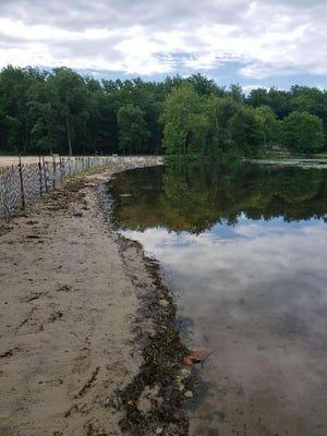 The water in the main beach area of Swartswood Lake, shown here fenced off due to the coronavirus pandemic on July 20, has tested positive for harmful algal blooms, or HABs.