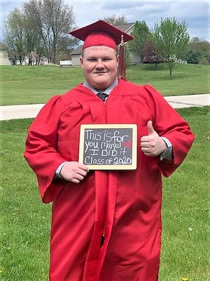 Springfield High School Class of 2020 graduate Cameron Whited holds up a sign thanking his mother during the school's virtual graduation ceremony held earlier this summer.