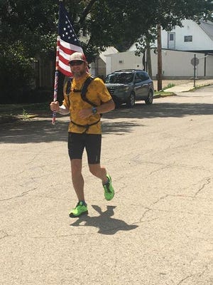 Bolivar's Stephen Strawn ran 52 miles while carrying a flag on behalf of  veterans.