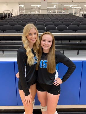 On Rock Hill High School's volleyball roster this season are seniors Montana Crumbaugh (12), left, an outside hitter, and setter Taylor Bass (15).