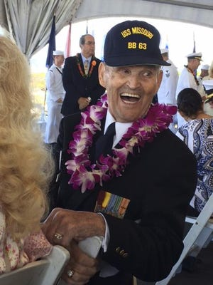 In this photo provided by Kathy Brent, World War II veteran Art Albert laughs during a surrender anniversary ceremony aboard the USS Missouri in Pearl Harbor, Hawaii, on Sept. 2, 2017. Albert, who had come to Hawaii for every commemoration, had promised loved ones that he would make it to the 75th anniversary of the surrender in 2020. But he died in June. Several dozen aging U.S. veterans will gather in Pearl Harbor in September to mark the event, even if it means the vulnerable group may be risking their lives again amid the coronavirus pandemic.