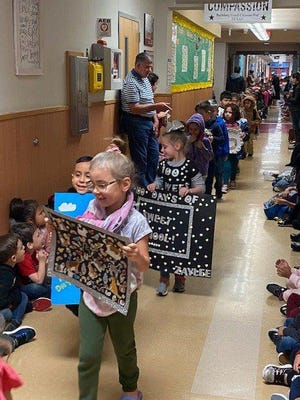 In this January 2020 photo, Bastrop school district elementary students, teachers and staff celebrate the 100th day of the school year.