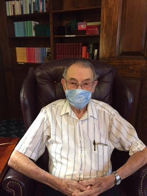 Dick Durette, masked per quarantine COVID-19 restrictions, is a 103-year-old alumni of Dover High School.