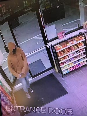 Rochester police are searching for a man who allegedly robbed a Nouria convenience store at knife point Monday evening.