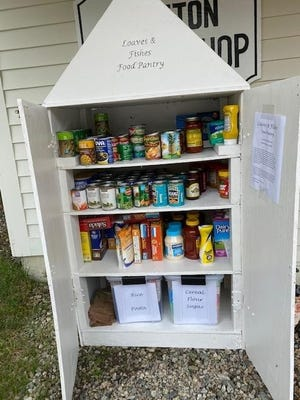 """The Congregational Church of Grafton, 30 Grafton Common, is providing a small """"take it or leave it"""" food pantry cupboard for the benefit of anyone in town who may find they are in need of additional food supplies."""