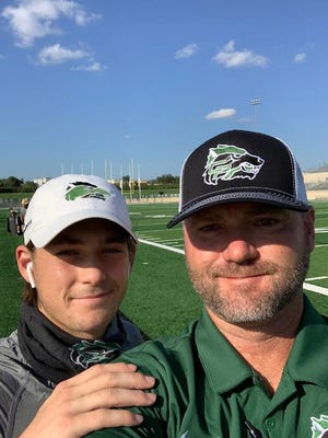 Gunnar and Carl Abseck have taken selfies such as this one before every game since the senior receiver played at nearby Cedar Park Middle School.
