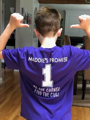 Tyler Peterson ran five miles around Hingham recently to raise funds for pediatric cancer research in the memory of his friend Maddie McCoy.