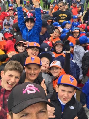 Former Saugus Little League president Tom Whittredge is shown taking a selfie with some of the players after the Opening Day ceremony at the Elks Field in 2019. High school seniors from area schools who have played in the program over the years are once again eligible for two $1,000 scholarships in the names of Stephen Wing and Peter LaCortiglia.