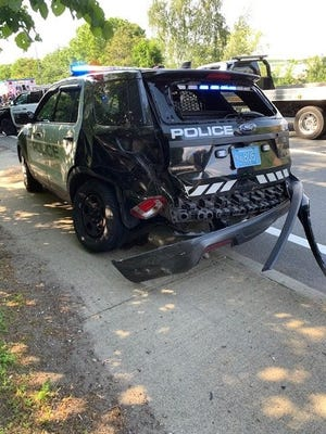 Braintree police arrested a man Wednesday they say intentially ran his car into a police cruiser.