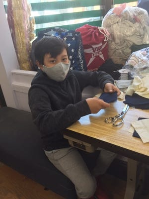 12-year-old Michael Nguyen of Brookline made masks for Hebrew SeniorLife's Center Communities of Brookline residents. He and his family, who own Harvard Street Cleaners, made 125 cloth masks. This is part of the donation of masks from the community to provide all Center Communities of Brookline residents with a cloth mask.