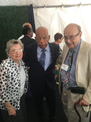 Gloria Greenbaum (left) and Lowell Greenbaum (right) stand with Rep. John Lewis in October at a luncheon for House Speaker Nancy Pelosi.