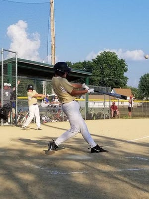 Ethan Harrison drives one of his two hits in the Championship game.
