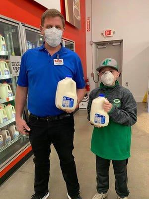David Santee, left, manager of Geneseo Save A Lot, and 11-year-old Eli Palmer, Geneseo, received sufficient donations to be able to continue to provide free milk for families in the Geneseo School District.