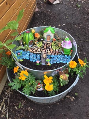 This container garden is an example of what an entry in the Marigold Festival Garden Contest may look like. Resultsx may vary, depending on the gardener.