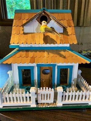 Ernie Wolf is selling his latest creation, a decorative birdhouse, and donating the proceeds to FOTAS.