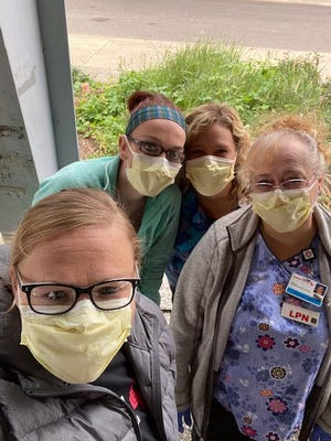 Memorial Physician Service Lincoln workers help with flu shots offered at the Illinois State Fairgrounds. From left are: Megan Bossingham, Ashley Bennett, Thais Eads and Donna Spiker.