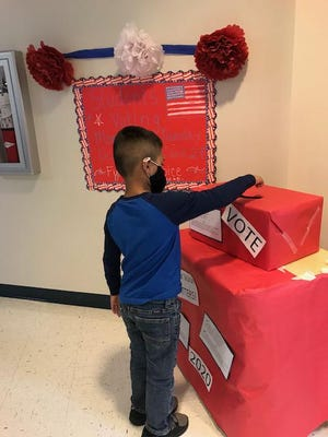 A Sugarloaf Elementary student casts a ballot during a mock election at the school recently.