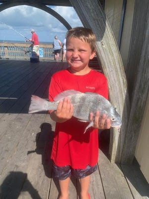Chase Jordan, 8, of Tybee Island fishes every day of his life, according to his family. The student at St. James Catholic School eats, sleeps and dreams fishing. This is a picture of him catching his first black drum all by himself. He caught this fish on the Tybee Island pier while at his father Tommy Jordan's shop, RipTide Bait and Tackle.