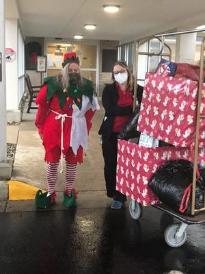 """Bonnie Glisson, left, delivered 91 gift bags on Monday to Lenawee Medical Care Facility in Adrian. The Fairfield Township woman said she wanted the resident to know they are """"thought of and loved."""""""