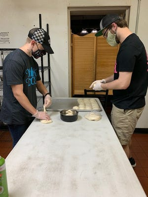 Charles Rhymer and Ben Stafford prepare pizza dough at The Local, a restaurant and bar in downtown Centreville. Owner Dan Templin said restrictions due to COVID-19 have resulted in a new business model focusing almost exclusively on pizza. The concept has been wildly successful, he said.