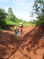kids carrying water.jpg