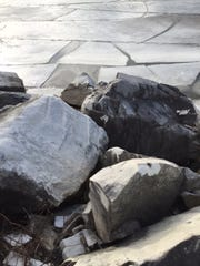 Ice forms next to the white marble blocks along the Colchester causeway.