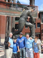 Three generations of McClures are Royals fans. From left: Earl McClure, 80, grandsons Gregory McClure, 9, and Noah McClure, 18; son Cory McClure; and step-son Canden Gantendian, 11.