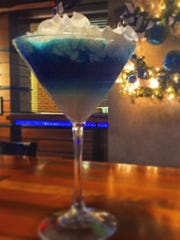 This blue and white martini at Colts Grille is topped with whipped to make it look snow-covered.