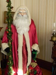 An old-fashioned Santa greets visitors inside the 1897