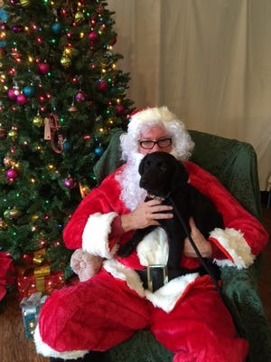 Mary Jo Conley's husband Michael with adoptee Pandora at Big Dog Rescue Project's Christmas Fundraiser.