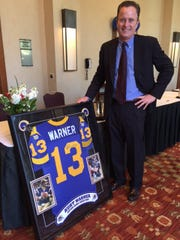 Valley resident John Yocca was the high bidder for the framed Kurt Warner jersey at the Sports Heroes Luncheon, benefiting the Boys & Girls Clubs of Coachella Valley, on Feb. 19, 2015 at the Hyatt Regency Indian Wells Resort & Spa.