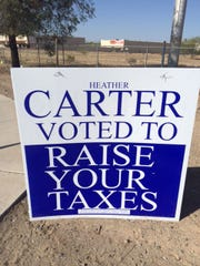 The Arizona Taxpayers Action Committee put up signs saying Rep. Heather Carter, R-Phoenix, voted to raise taxes. The group's treasurer said the reference is to the Legislature's 2013 vote to expand the state's Medicaid program. But azcentral Fact Check determined the expansion vote was not a tax.
