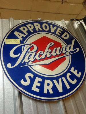 This sign is a reproduction. Bradley's guide lists a similar authentic sign from the 1930s at $3,300. The Packard sign was priced for less than $50.