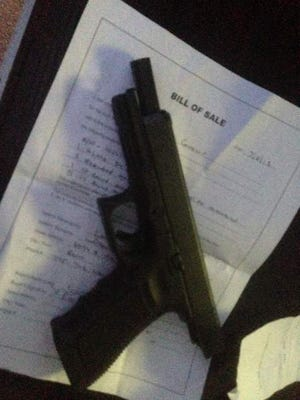 Jill Schaller took a picture of the Glock pistol and bill of sale before returning it to seller.