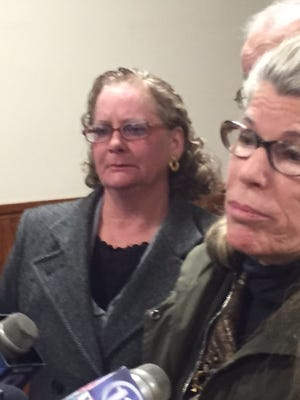 René Bailey, left, after court Thursday with attorney Adele Bernhard.