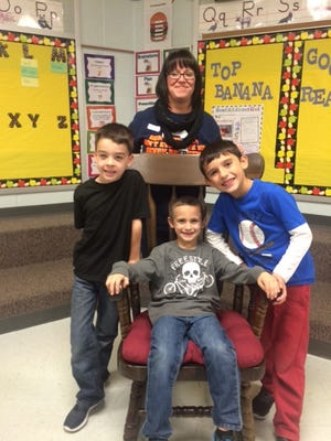 Mark Smith (seated) with his mom, Cole Brandt (left) and Joseph Larro.