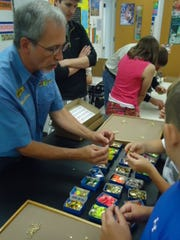 Mike Keen helps student choose and assemble spinners.
