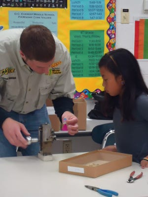 Mike Sheldon shows a student how to wrap and finish a lure.